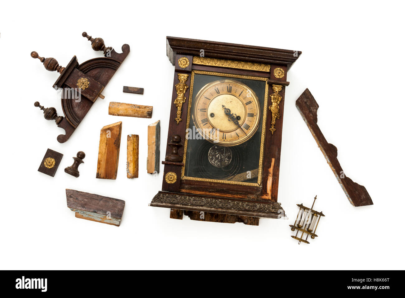 Broken antique clock ready for restoration by a horologist - Stock Image