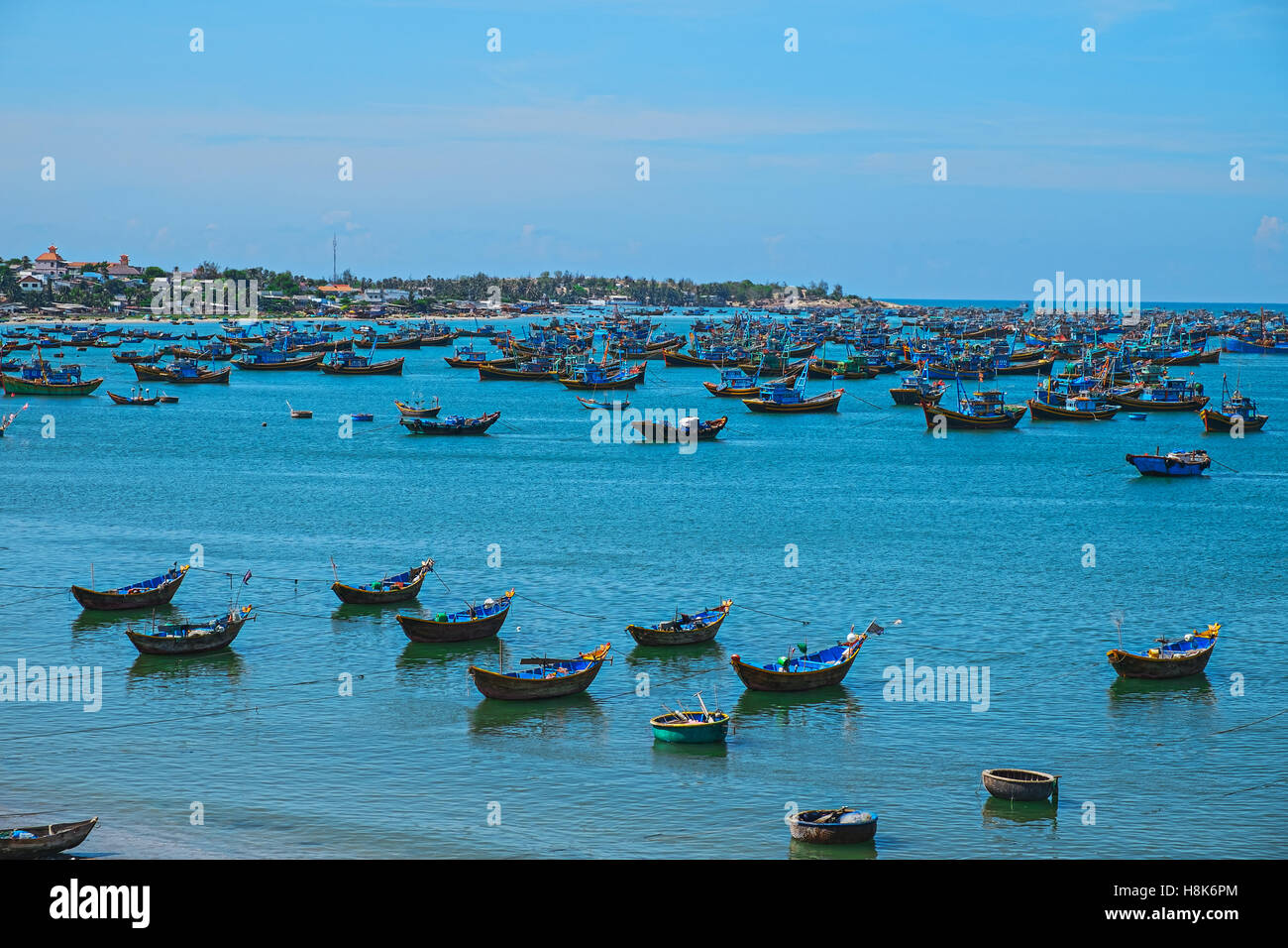 Vietnamese fishing village, Mui Ne, Vietnam, Southeast Asia. Landscape with sea and traditional colorful fishing - Stock Image