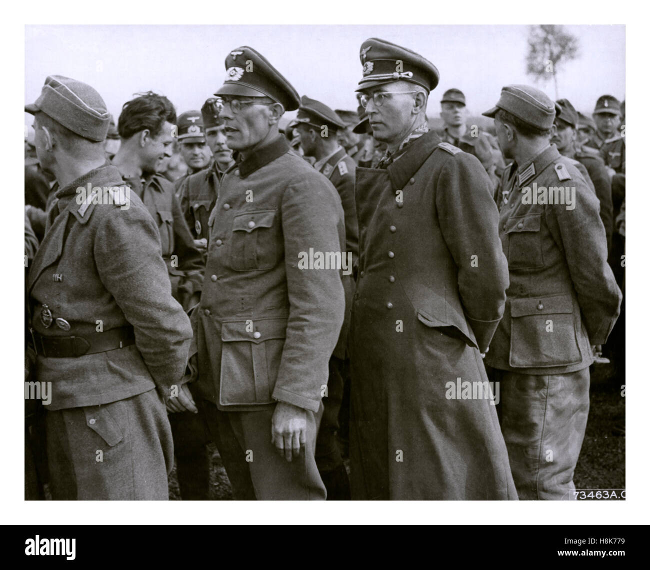 WW2 German prisoners of war, Wermacht officers and enlisted men in uniform standing grouped together - Stock Image