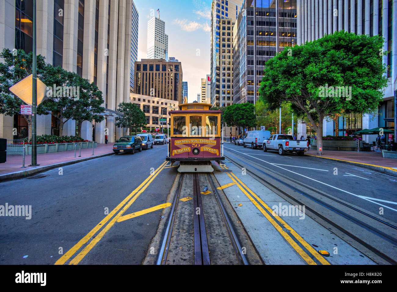 SAN FRANCISCO, USA - DECEMBER 16: Passengers enjoy a ride in a cable car on Dec 16, 2013 in San Francisco. It is - Stock Image