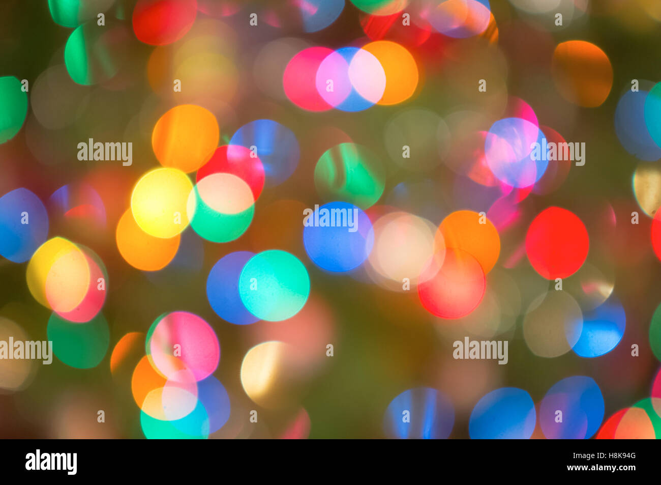 A background of colourful Christmas lights, thrown out of focus - Stock Image
