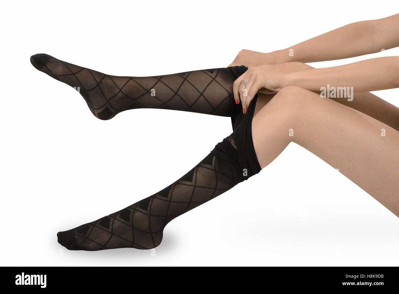 Woman legs dressing up her nylons pantyhose stockings Stock Photo