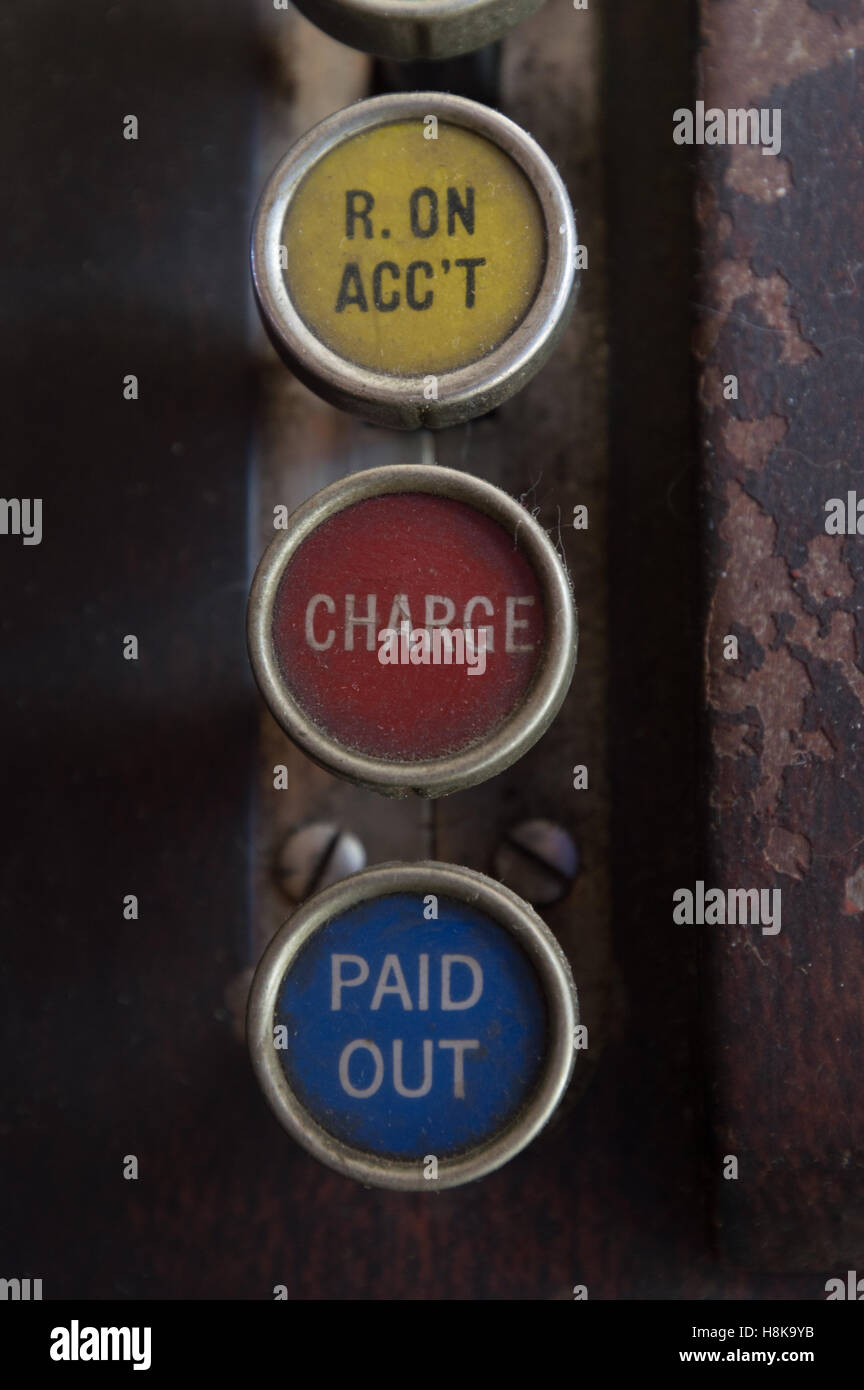 Close up of antique wooden cash register with three keys label R. ON ACC'T (received on account), charge and - Stock Image