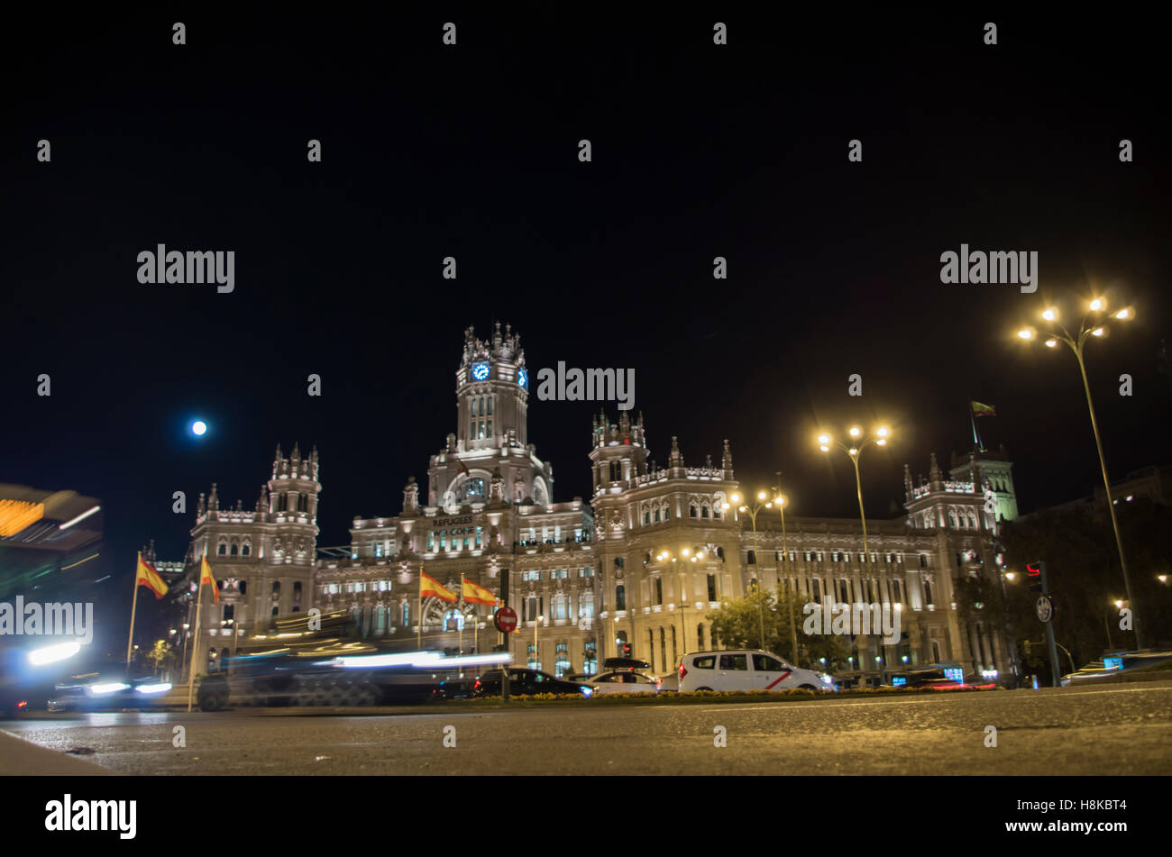The largest moon in the last 70 years captured over one of the main touristic sports of Madrid, the Square of Cibeles. Stock Photo