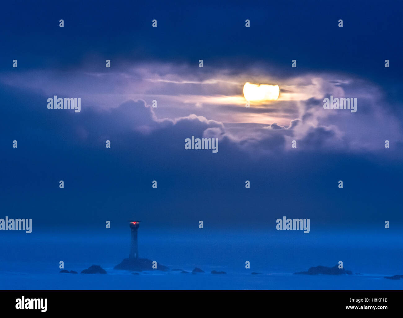 Lands End, Cornwall, UK. 14th Nov, 2016. UK Weather. The Supermoon sets over the Longships lighthouse at Lands End, - Stock Image