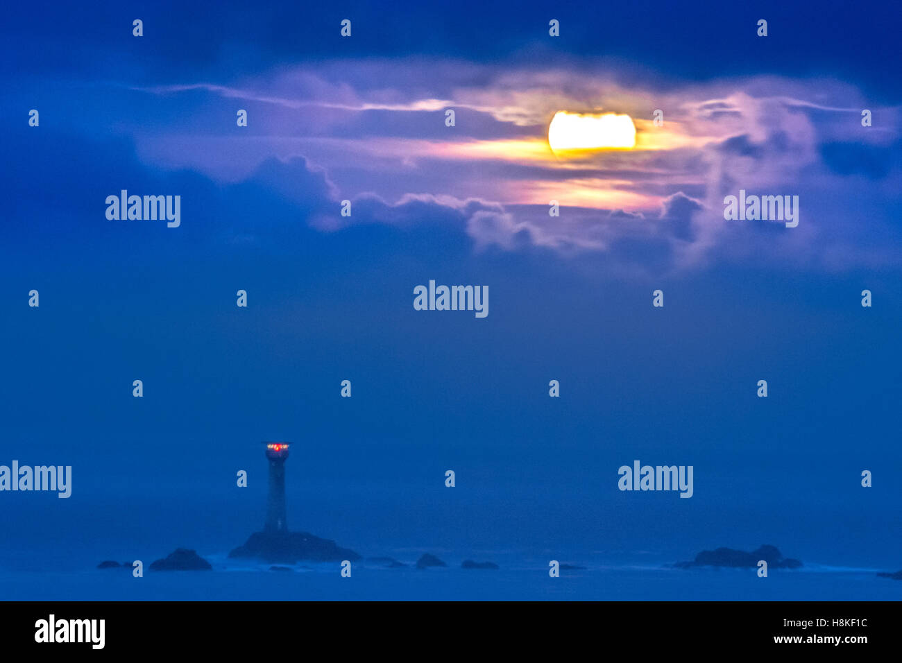 Lands End, Cornwall, UK. 14th Nov, 2016. UK Weather. The Supermoon sets over the Longships lighthouse at Lands End, Stock Photo