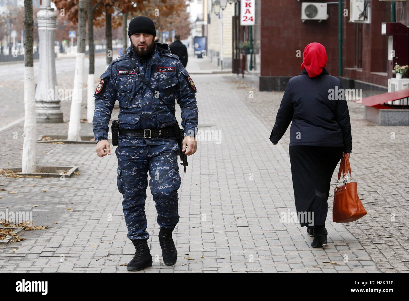 Grozny, Russia. 13th Nov, 2016. A policeman patrolling a city street. © Valery Matytsin/TASS/Alamy Live News - Stock Image