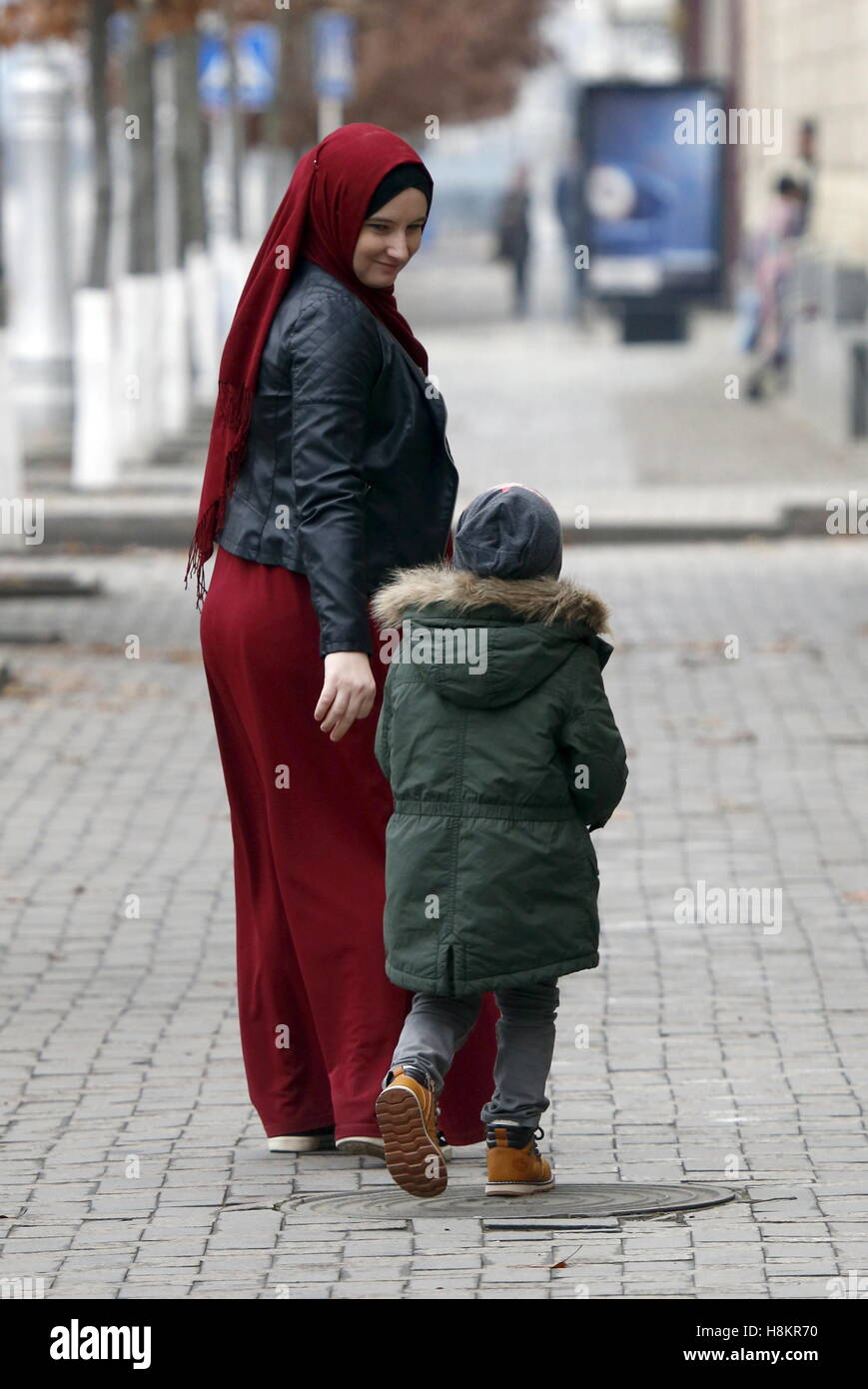 GROZNY, RUSSIA - NOVEMBER 13, 2016: A woman with son, wearing hijab [Muslim women's traditional headwear]. Valery - Stock Image