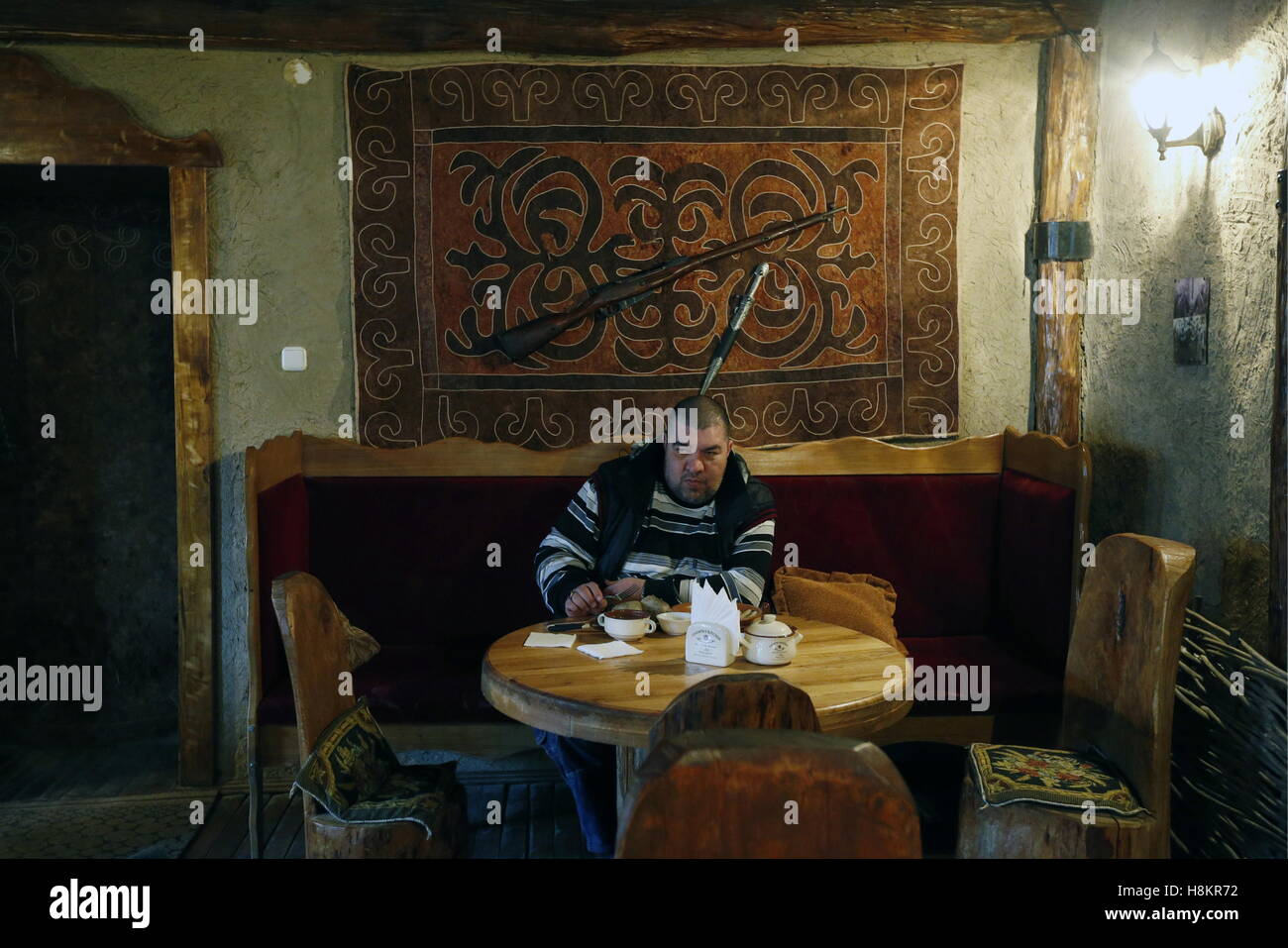 GROZNY, RUSSIA - NOVEMBER 13, 2016: A customer has lunch in a local restaurant. Valery Matytsin/TASS - Stock Image