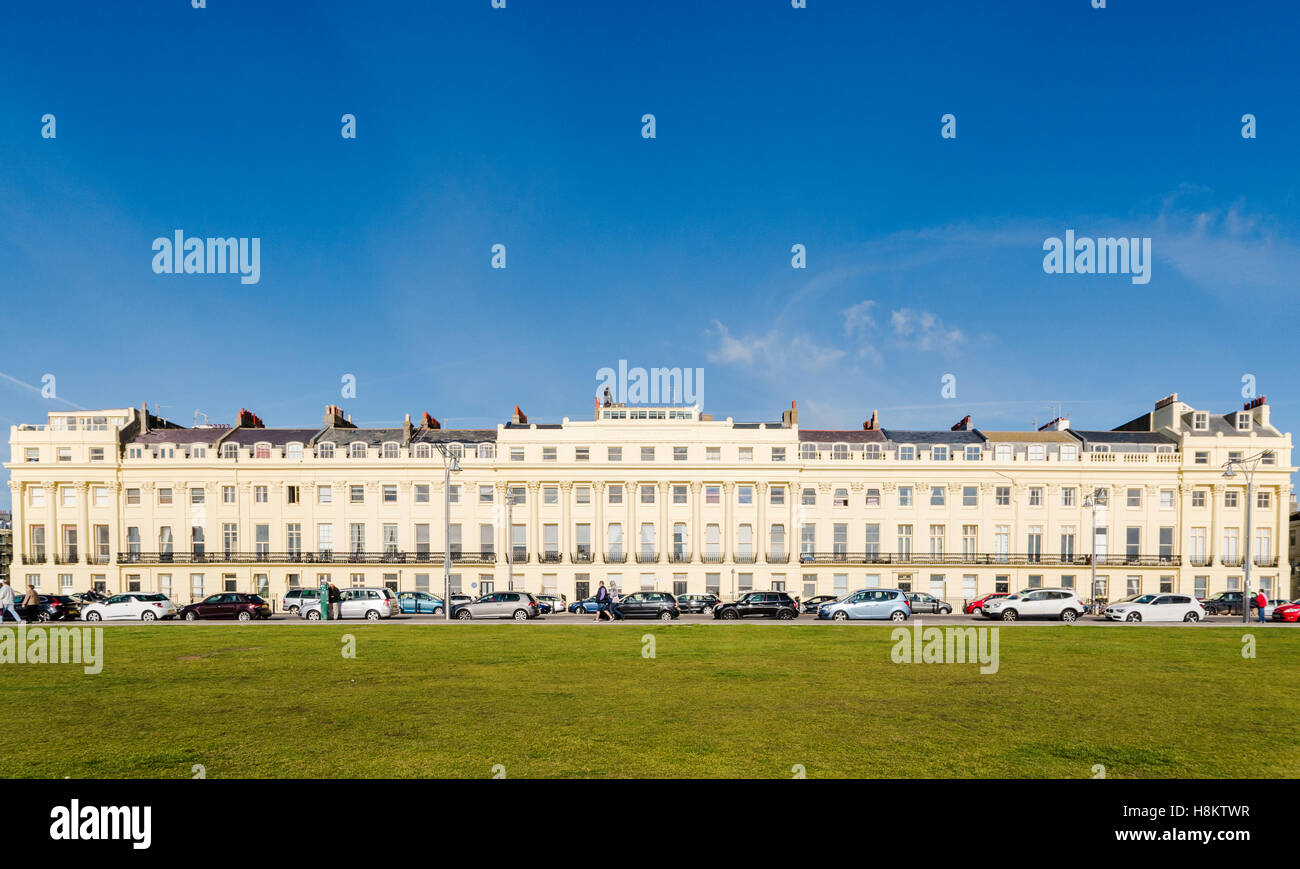 View of Hove Lawns and the Regency architecture of Brunswick Terrace in Brighton & Hove, Sussex, UK. - Stock Image
