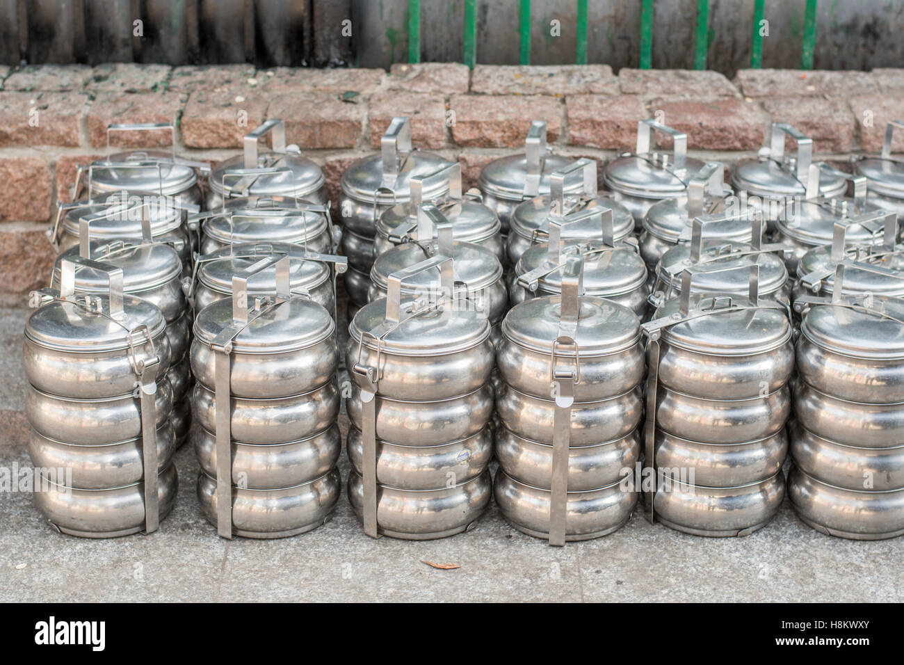 Cairo, Egypt. Close up of silver stacked lunch pales for sale in the outdoor bazaar/ flea market Khan el-Khalili Stock Photo