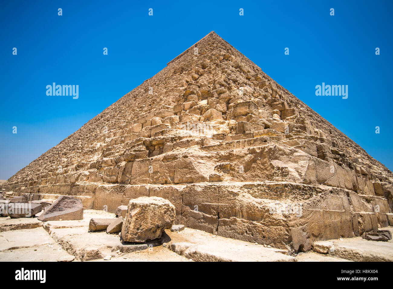Cairo, Egypt. Close up worm's eye view of the casing stones (limestone) that make up The Great Pyramids of Giza. - Stock Image