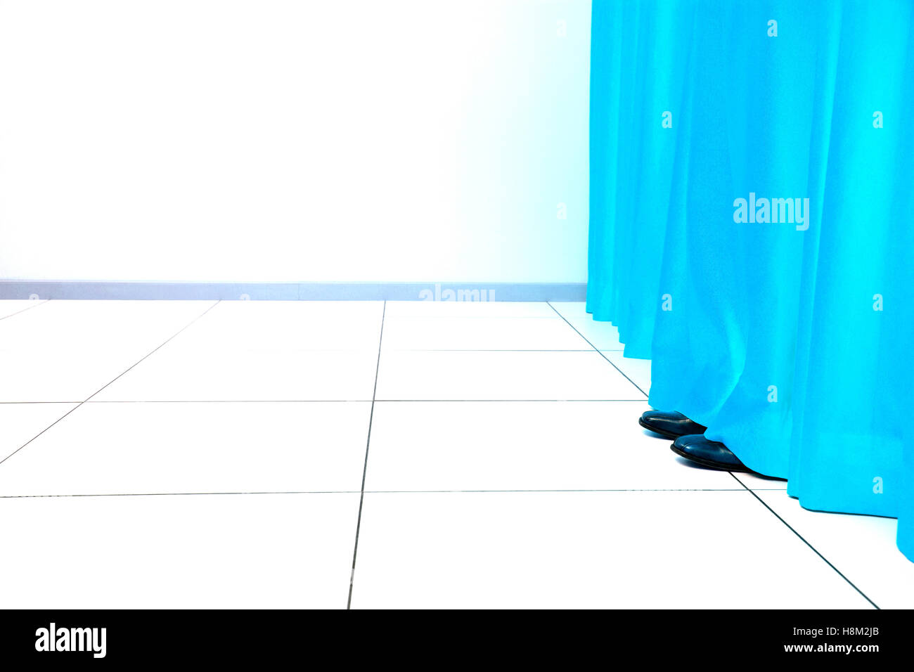 Feet Behind Curtain - Stock Image