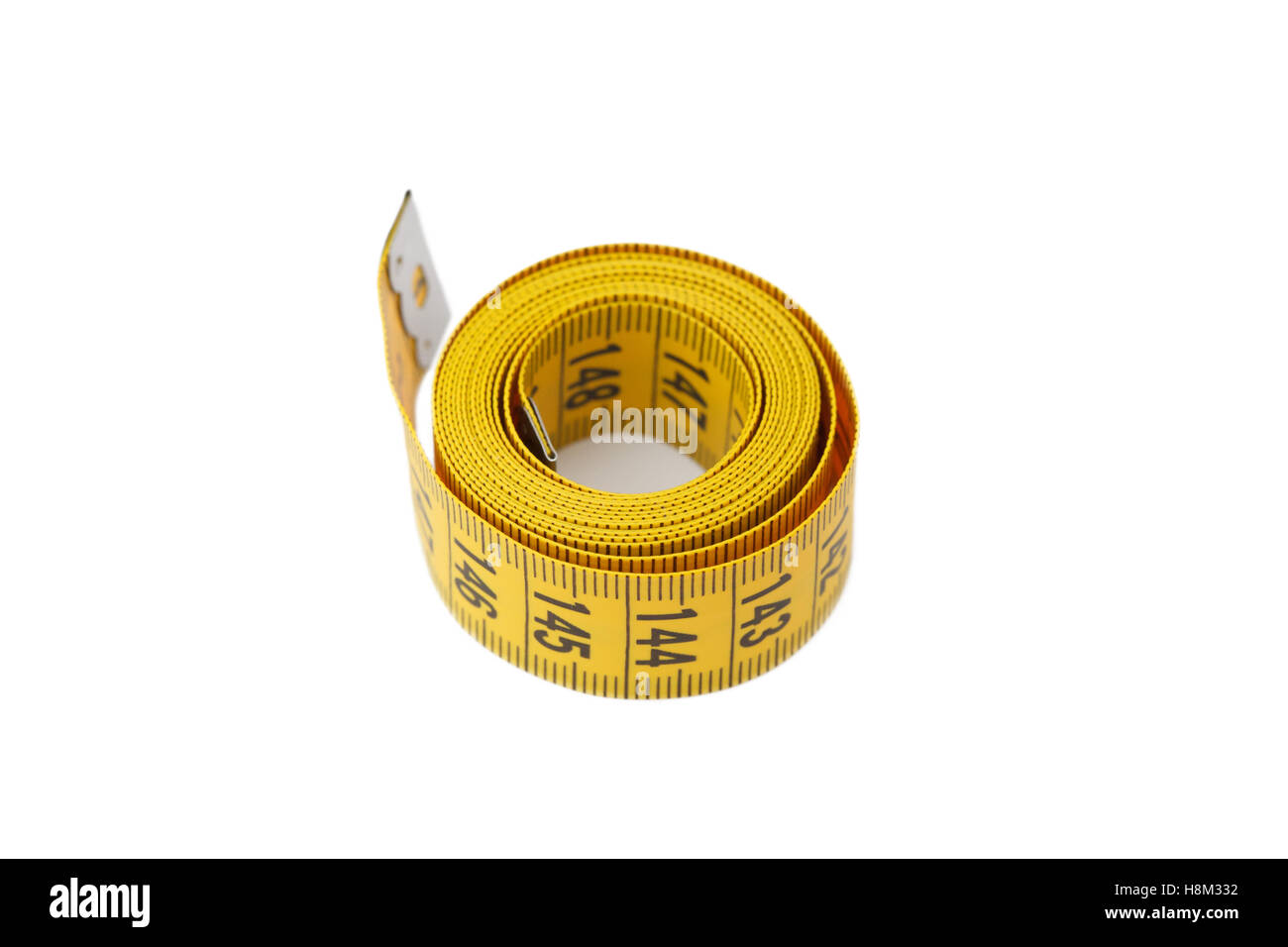 Measuring tape of tailor isolated on white background, close-up - Stock Image