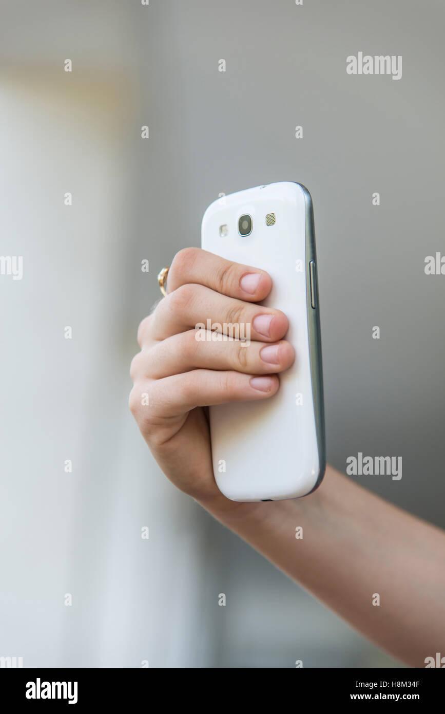 Teenage girl using mobile smart phone - Stock Image