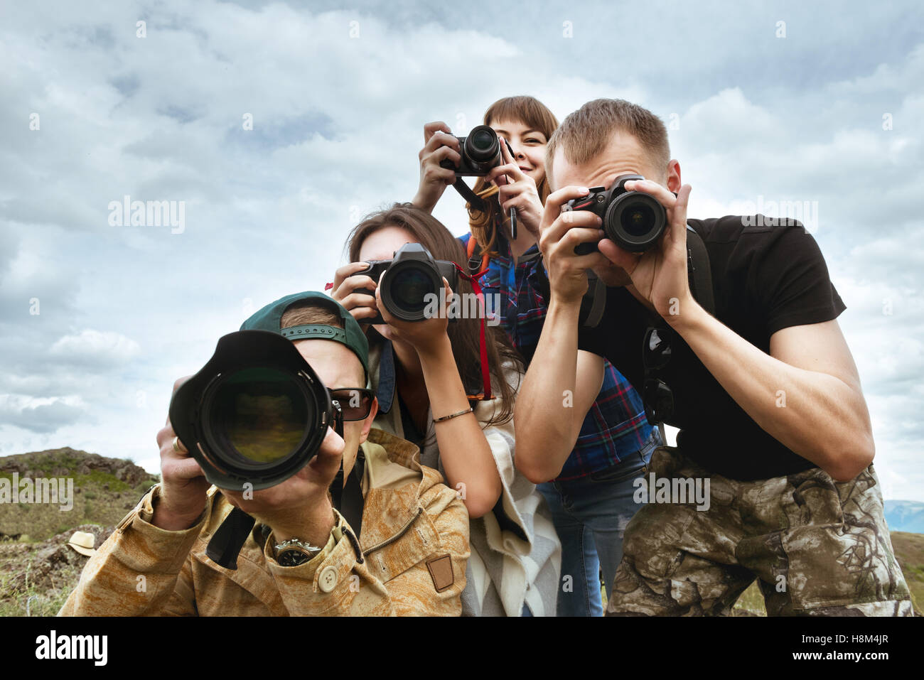 Group friends photographers taking photo - Stock Image