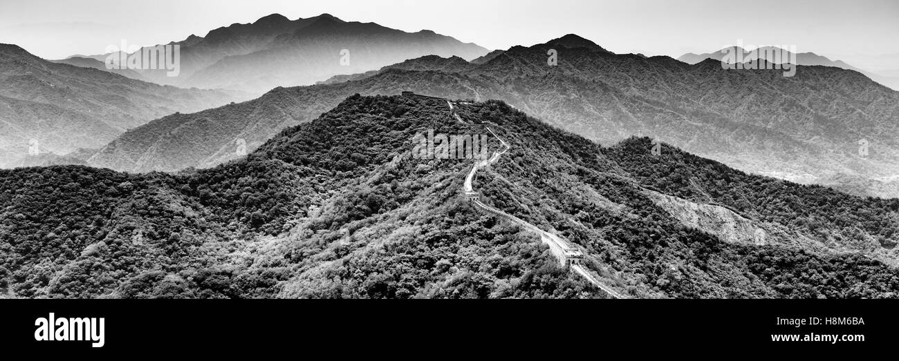 Mutianyu, China - Landscape view of the Great Wall of China mountain range. The wall stretches over 6,000 mountainous - Stock Image