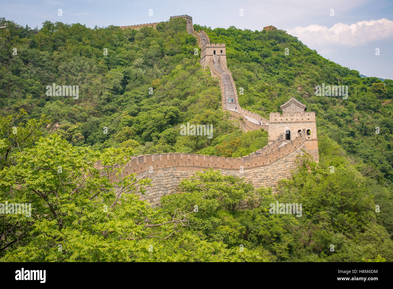 Mutianyu, China - Landscape view of the Great Wall of China. The wall stretches over 6,000 mountainous kilometers - Stock Image