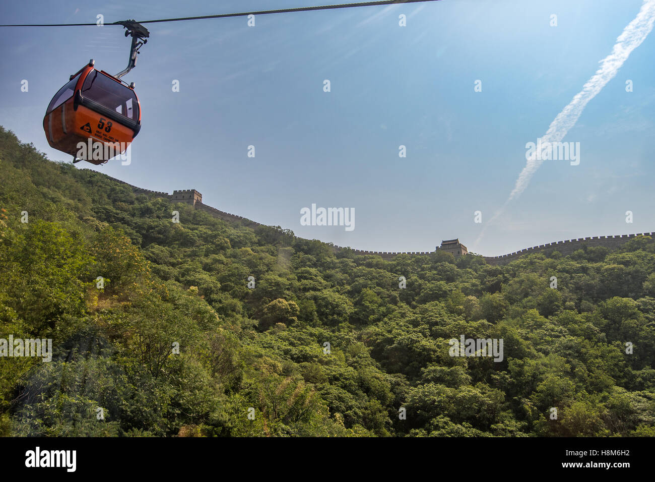Mutianyu, China - Outside view of a chairlift riding up to the Great Wall of China. The wall stretches over 6,000 - Stock Image