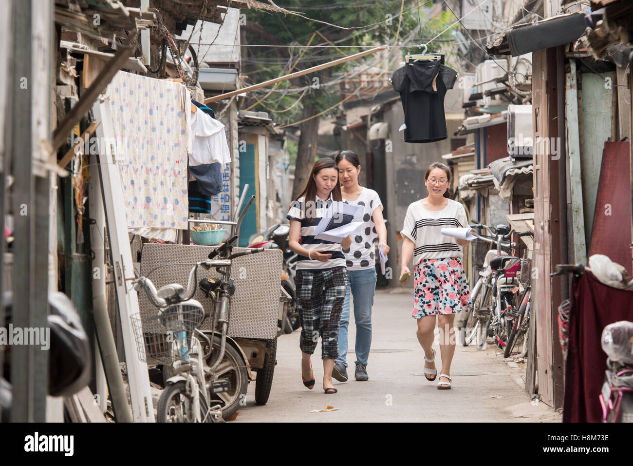 Beijing, China - Women walking in a Hutong located in Central Beijing. - Stock Image