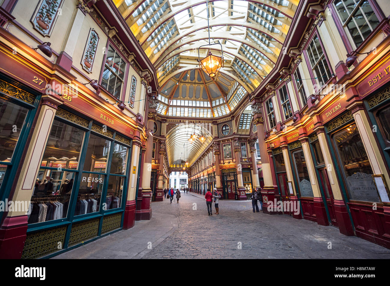 LONDON - NOVEMBER 3, 2016: Autumn light filters through the Victorian arcade of the Leadenhall Market, built in - Stock Image