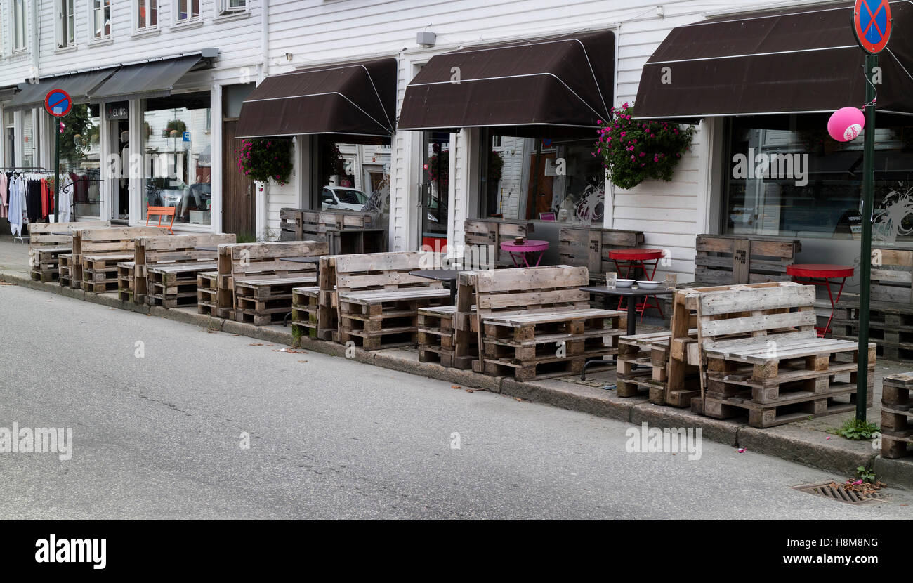 Restaurant with recycled benches in the center pf Kristiansand, Norway - Stock Image