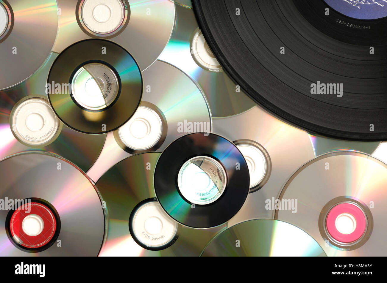 Compact discs and vinyl record, abstract background - Stock Image