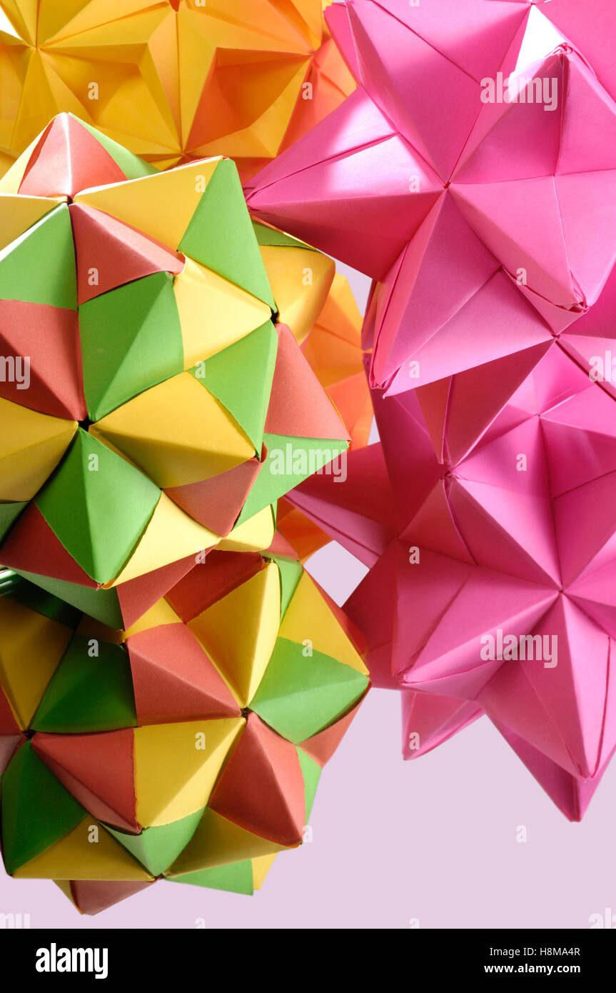 Colorful origami polyhedron figures - Stock Image