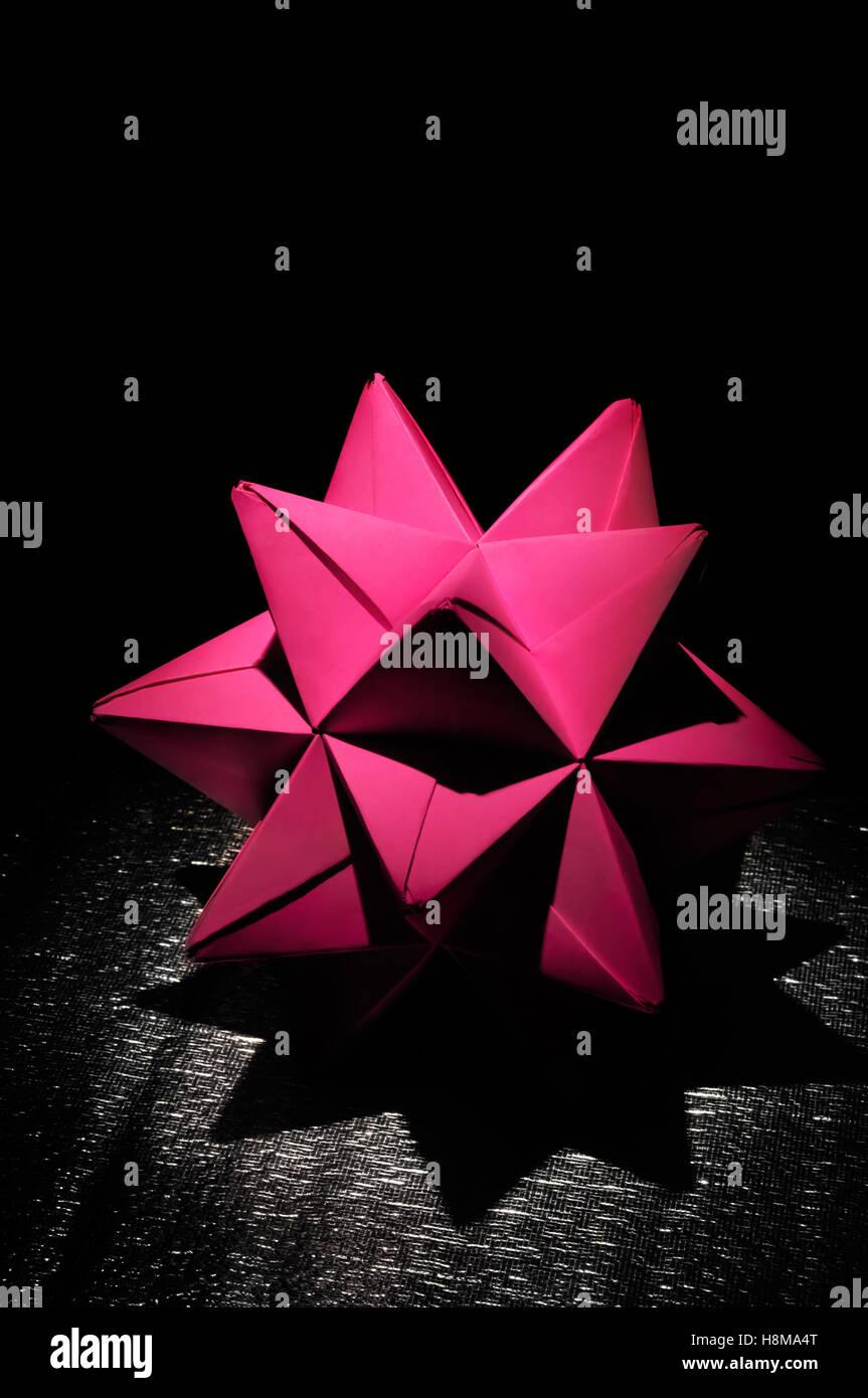 Purple origami polyhedron figure - Stock Image