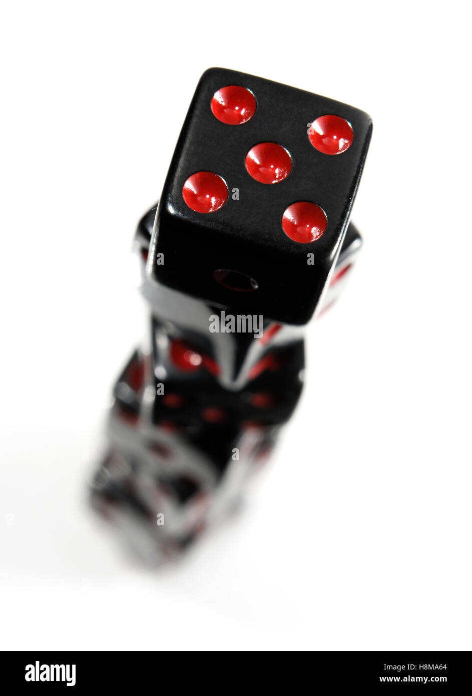 Stack of black playing dice - Stock Image