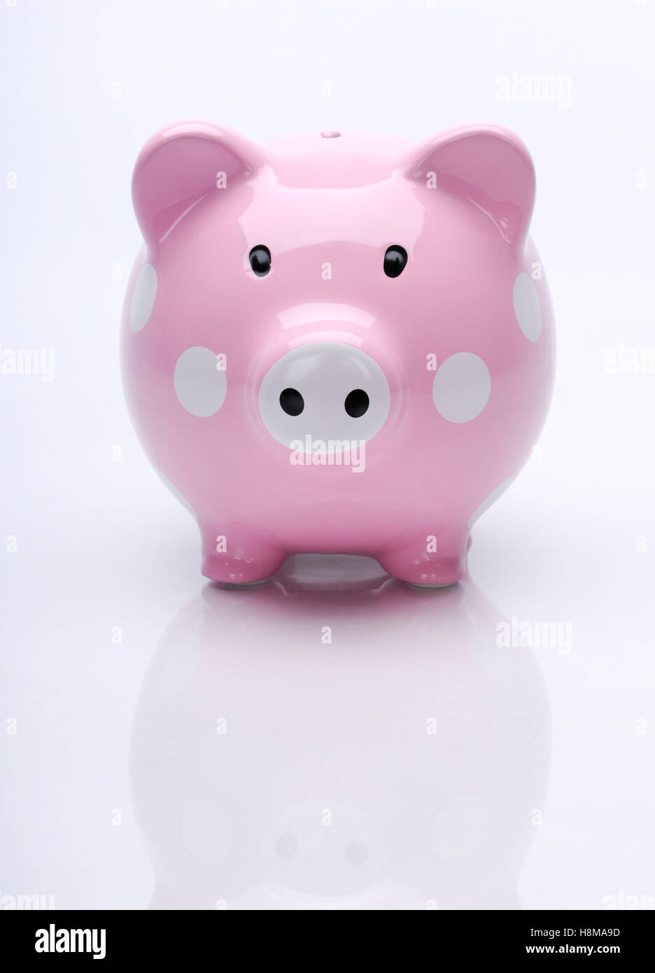 Cute pink piggy bank - Stock Image