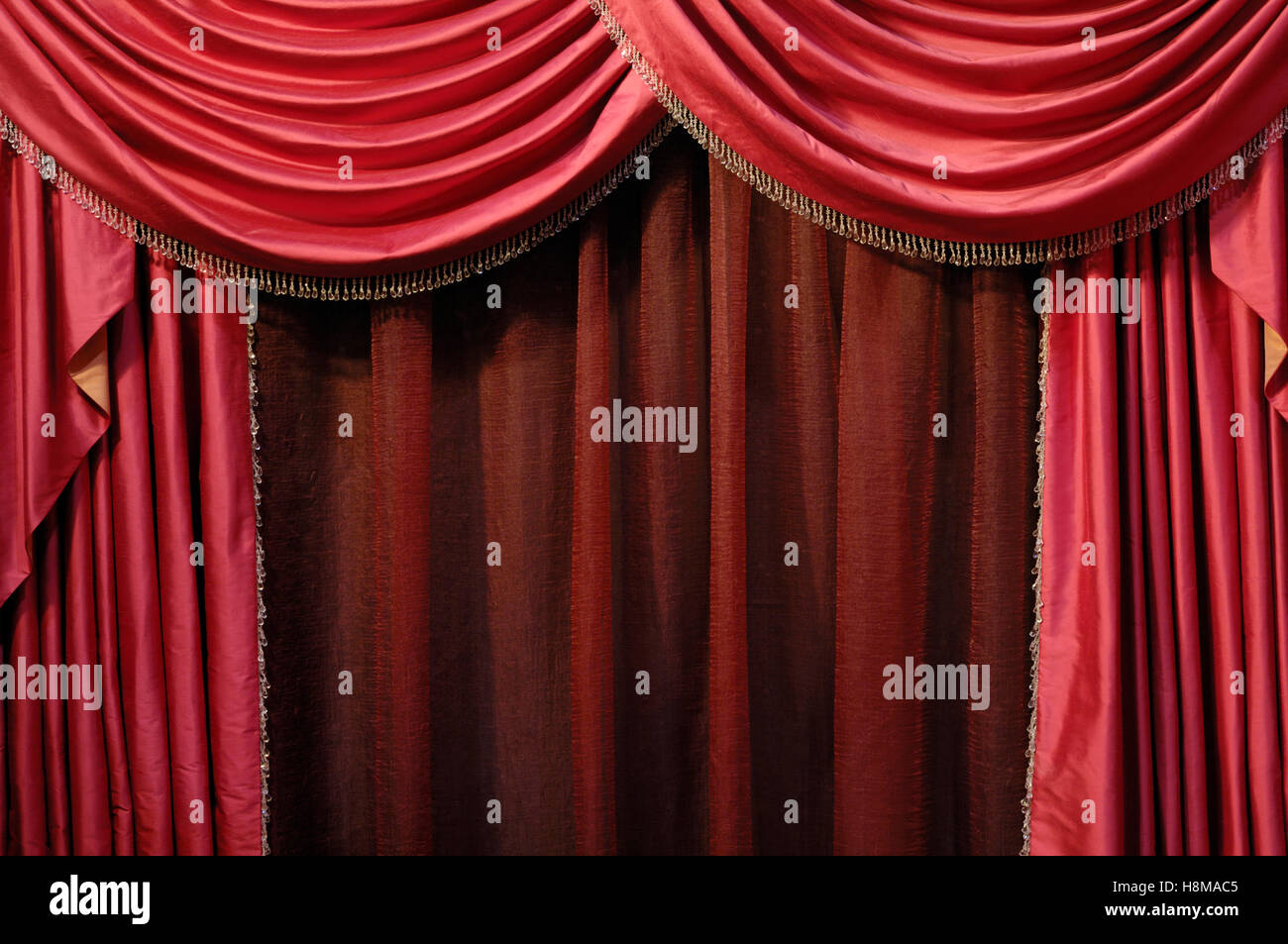 Red curtain, background - Stock Image