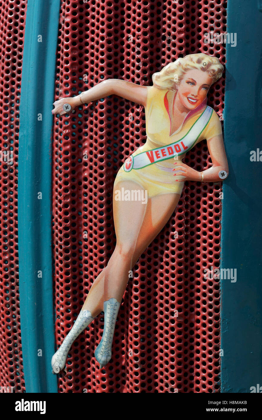 Cut-out of pin up girl tacked onto radiator grille, advertising Veedol oil, Germany - Stock Image