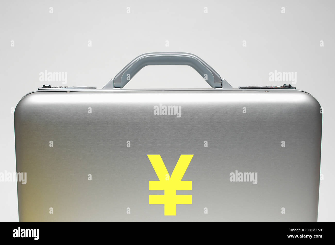 Silver briefcase with Yen Symbol - Stock Image