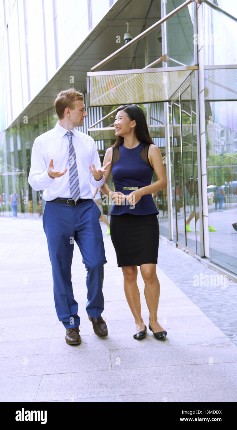 Multi Ethnic Business Team discussing the latest project outside - Stock Image