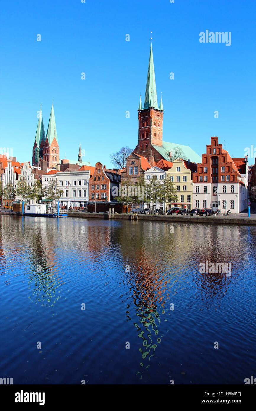 Lubeck old town with Marienkirche (St. Mary's Church) and Petrikirche (St. Peter's Church) reflected in - Stock Image