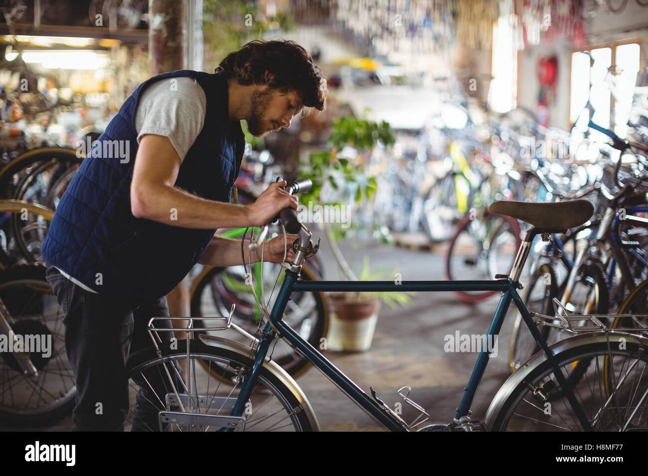 Mechanic examining bicycle Stock Photo