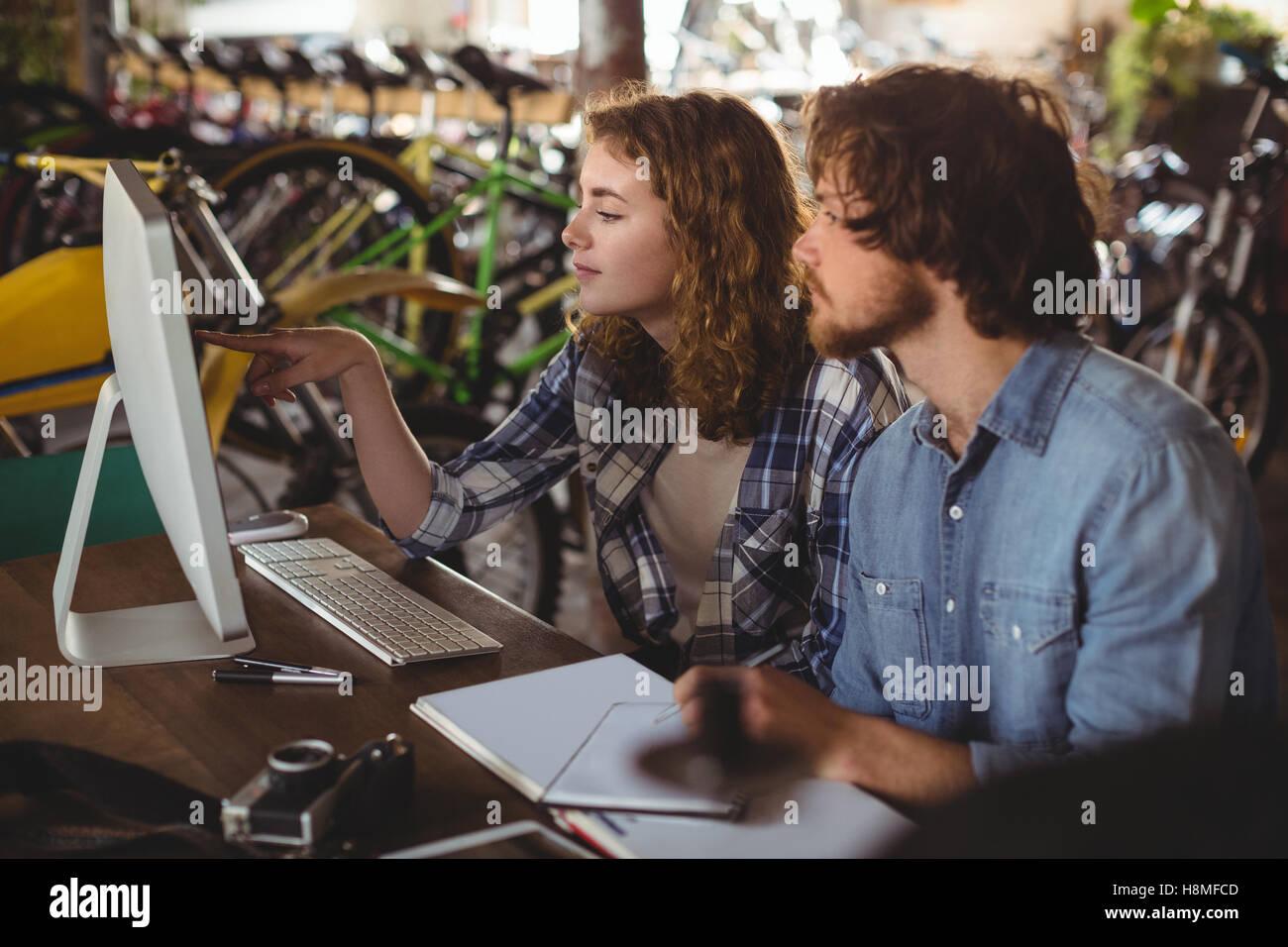 Mechanics working on personal computer - Stock Image