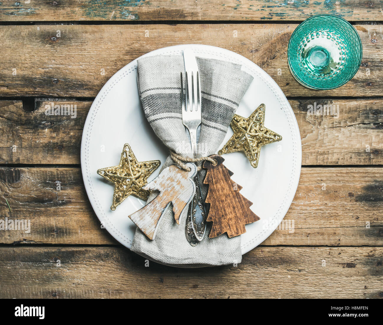 Christmas, New Year holiday table setting over wooden background - Stock Image