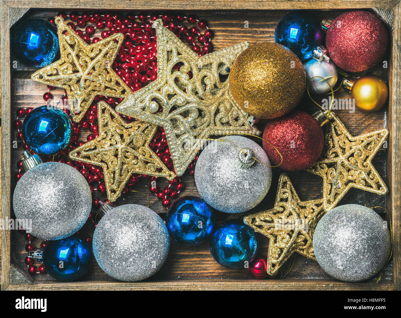 Christmas tree glittering toy stars, colorful balls and garland - Stock Image