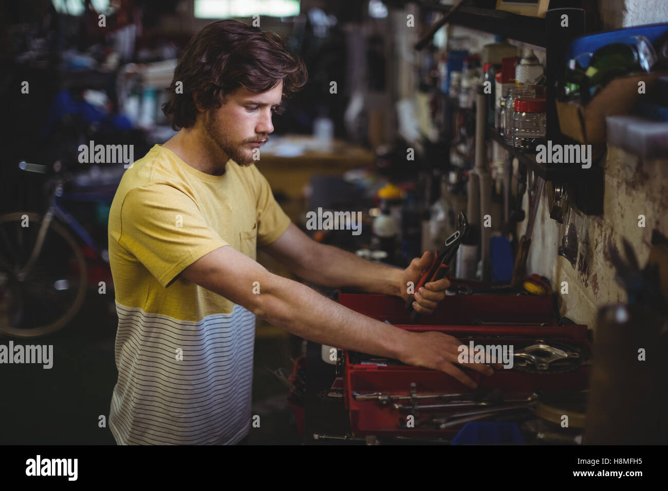 Mechanic selecting tools from toolbox - Stock Image