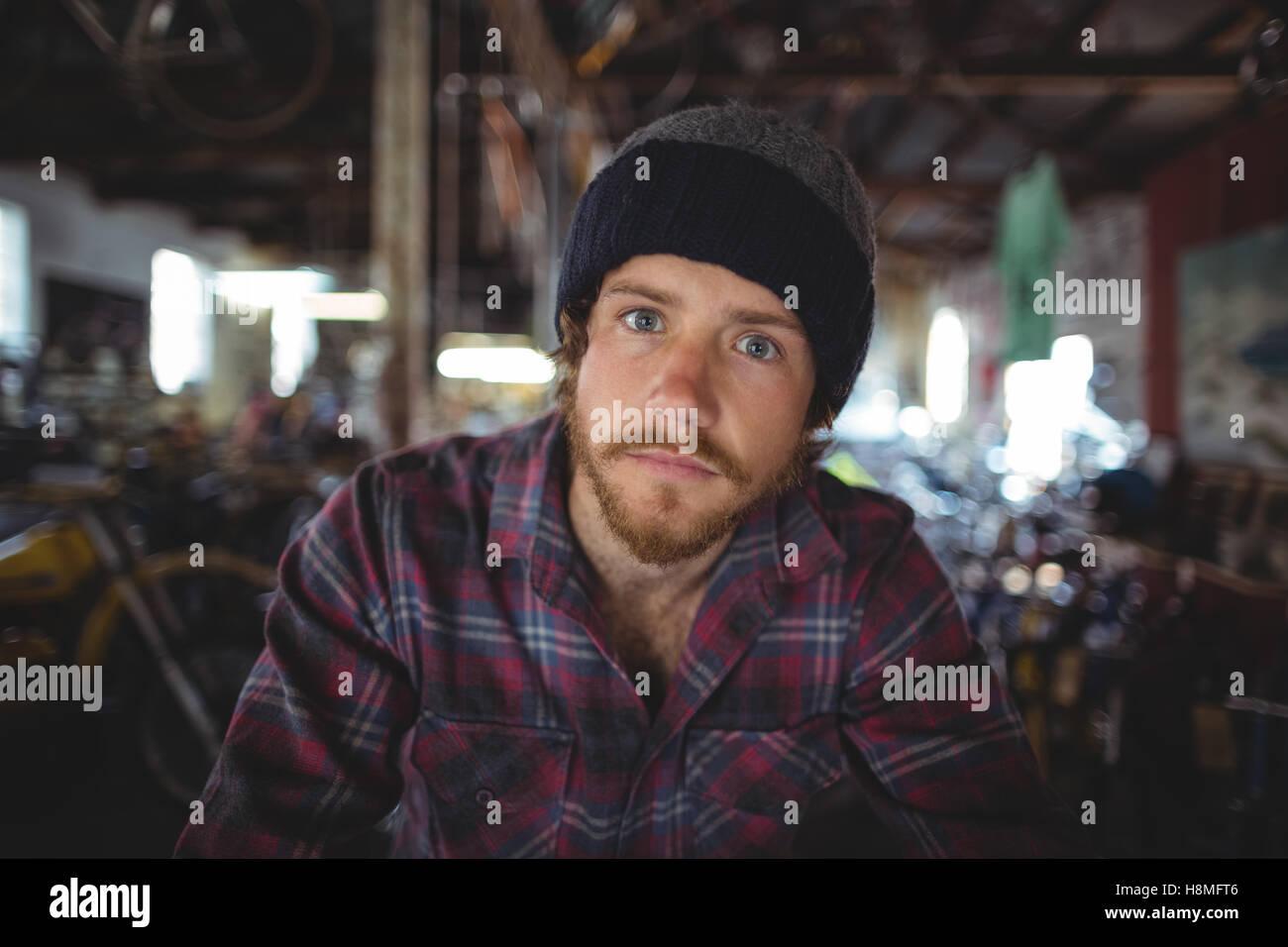 Portrait of confident mechanic - Stock Image