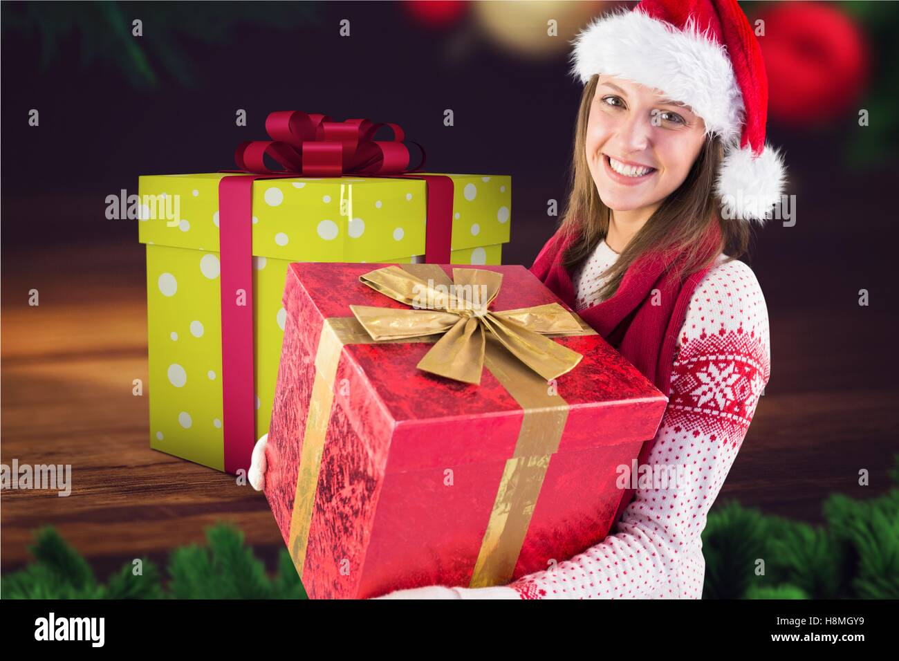 Beautiful woman in santa hat holding christmas gifts Stock Photo ...