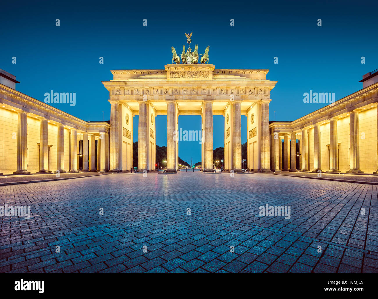 Classic view of famous Brandenburg Gate in twilight, central Berlin, Germany - Stock Image
