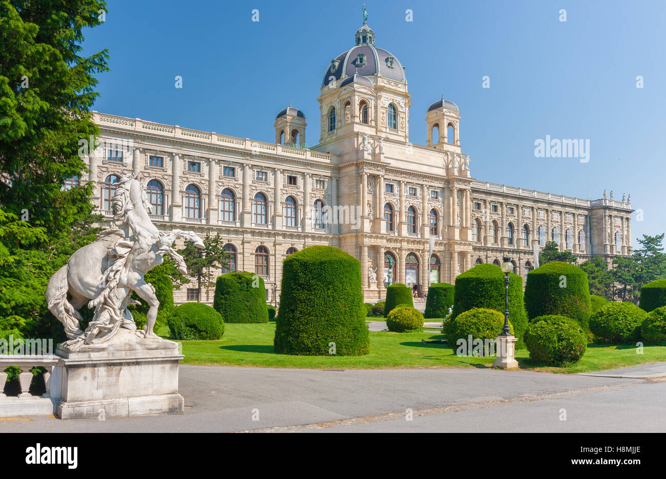 Classic view of famous Naturhistorisches Museum (Natural History Museum) with park and sculpture in Vienna, Austria - Stock Image