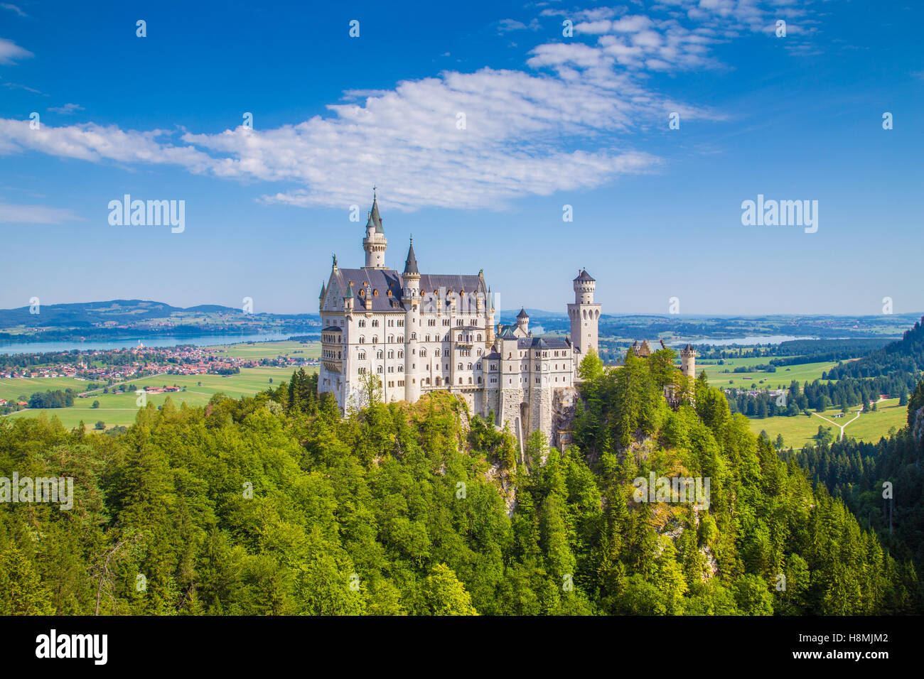 Classic view of world-famous Neuschwanstein Castle, one of Europe's most visited castles, on a beautiful sunny - Stock Image