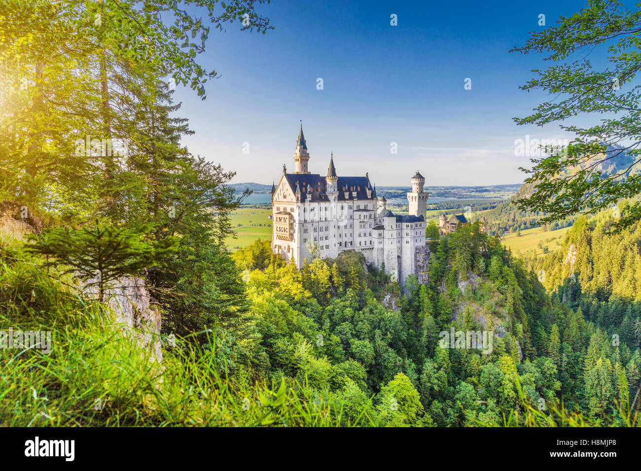 Classic view of world-famous Neuschwanstein Castle, one of Europe's most visited castles, at sunset, Bavaria, Germany Stock Photo