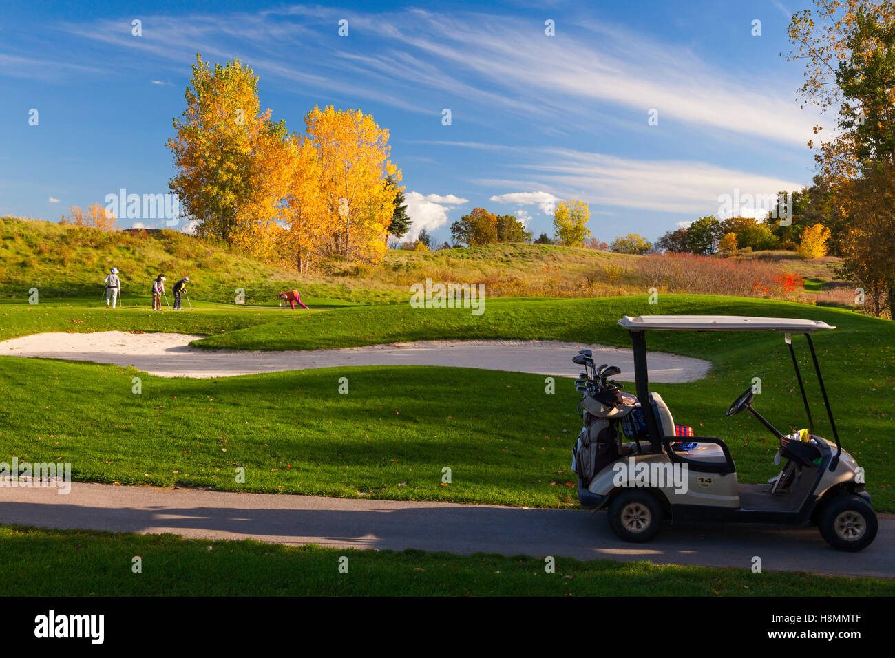 Golfers playing golf at Paris Grand Golf & Country Club in Paris, Ontario, Canada. - Stock Image