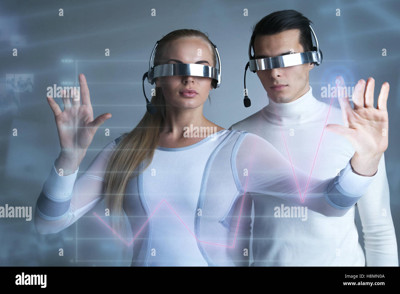 People in vr goggles touching a graph indicating growth on virtual display - Stock Image