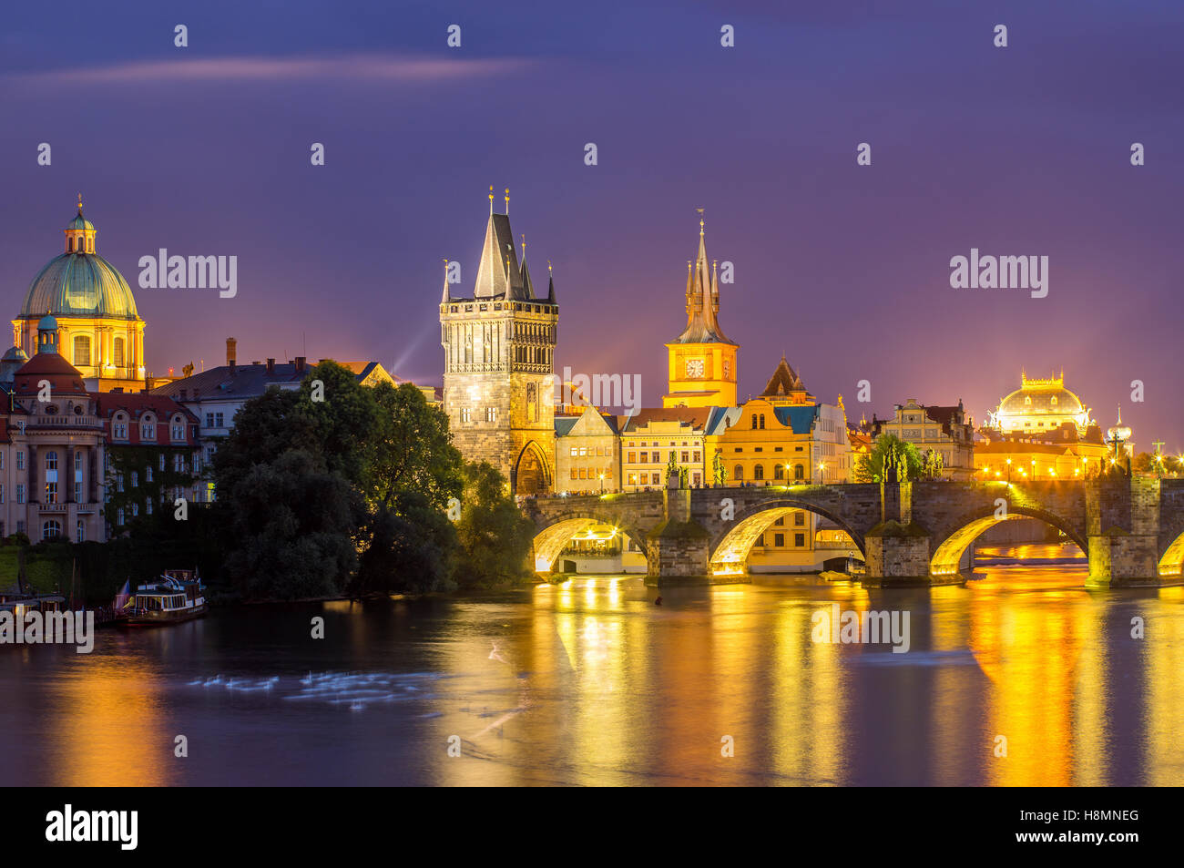 View of the River Vltava and Charles Bridge at Dusk Prague Czech Republic Europe - Stock Image